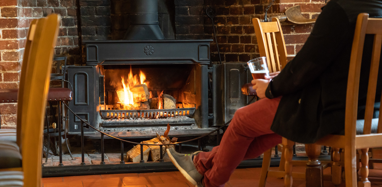 A woodburner with a roaring fire
