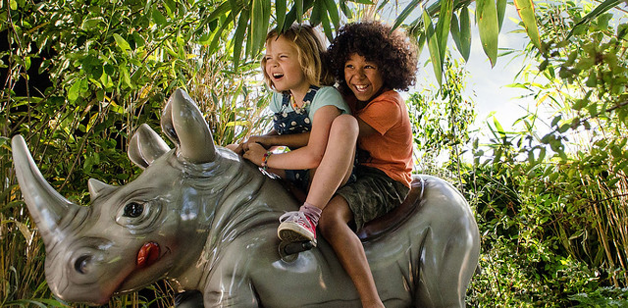 Children playing on a rhino ride at Longleat